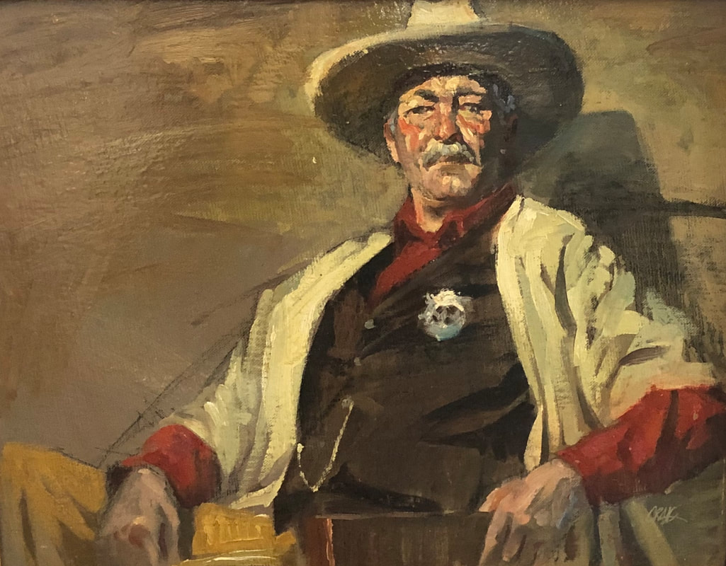Portrait of older man in sheriff's outfit and cowboy hat