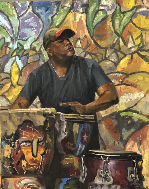 Man playing congas in front of wall mural