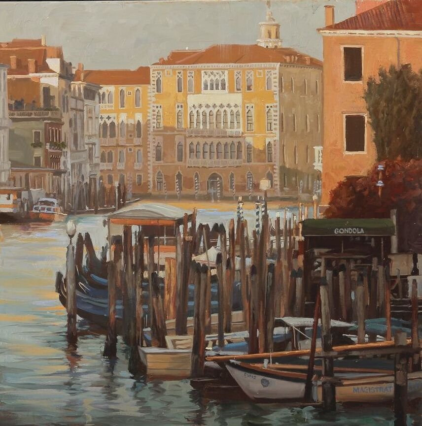 Gondola harbor with buildings in background