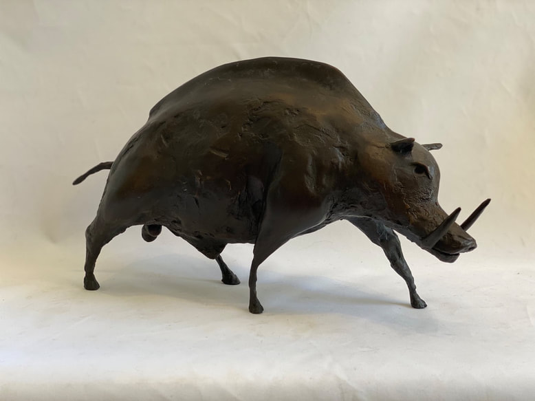 Abstract bronze sculpture of warthog