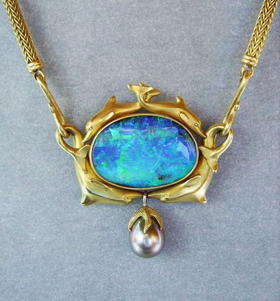 Image of 32 carat Black Opal in dolphin setting