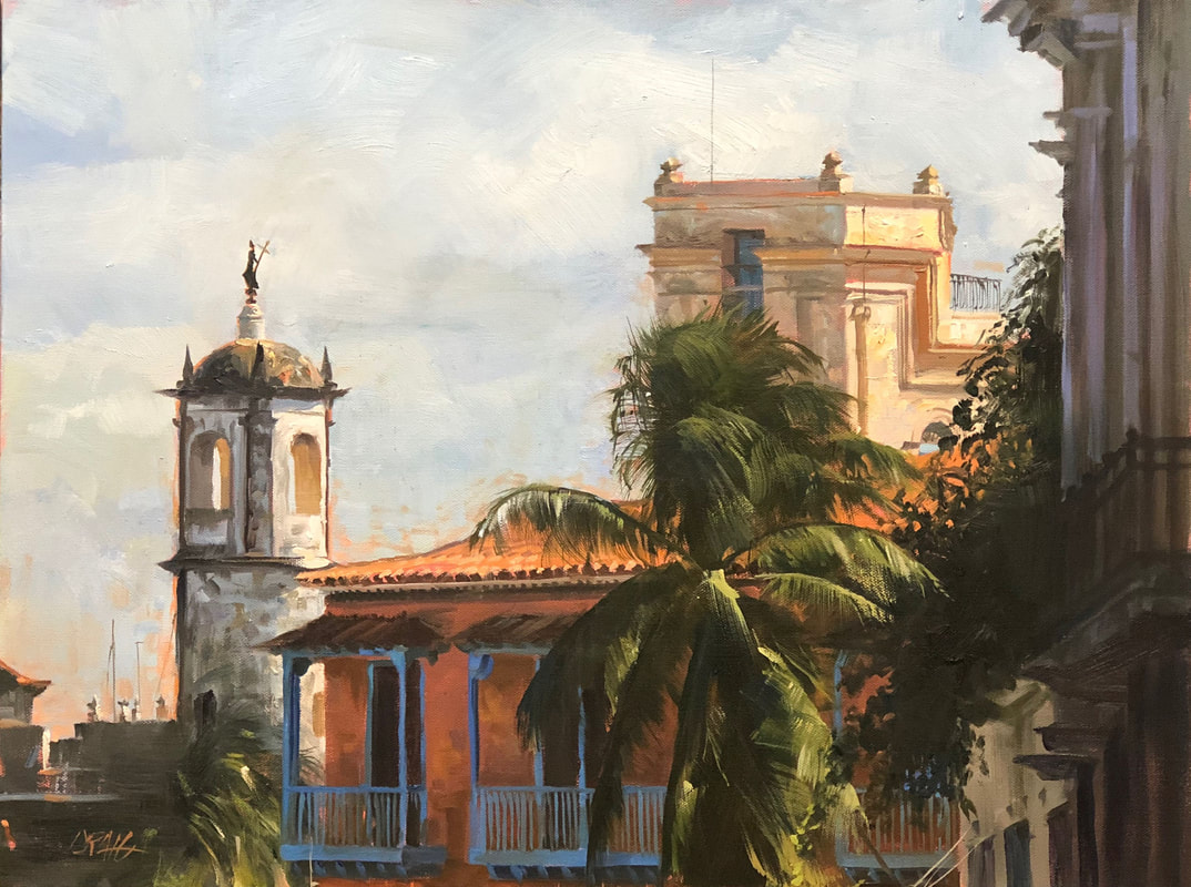 Havana architecture with balconies and palms against cloudy sky