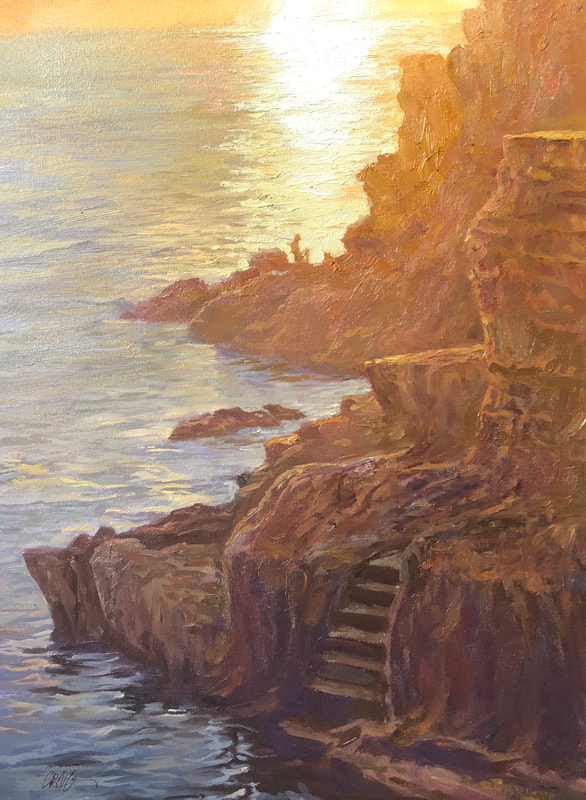 Landscape of coast line with staircase carved into the side of a cliff