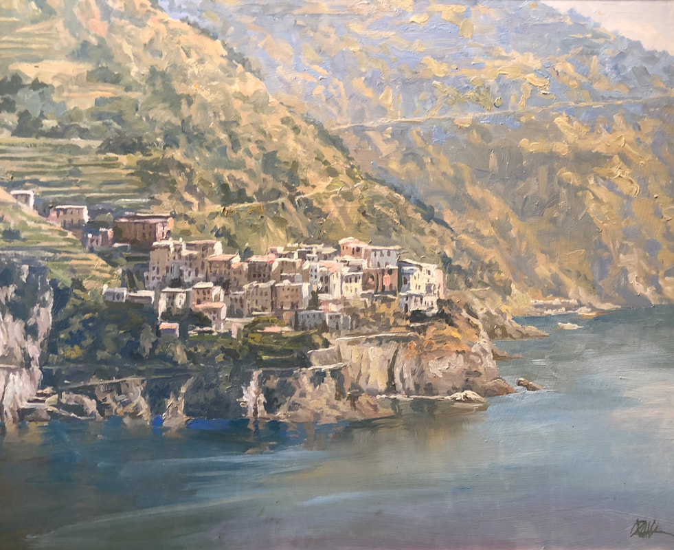Landscape of Ligurian coast with buildings on cliff above ocean