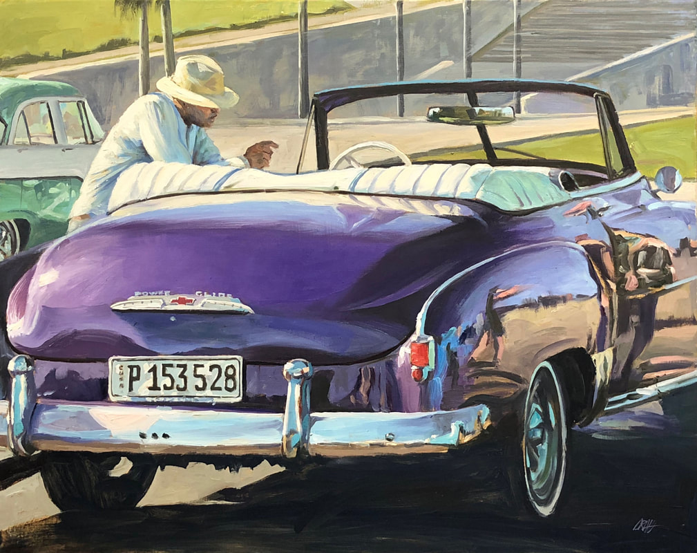 Dapper man leaning on 1950s purple Chevrolet coup convertible