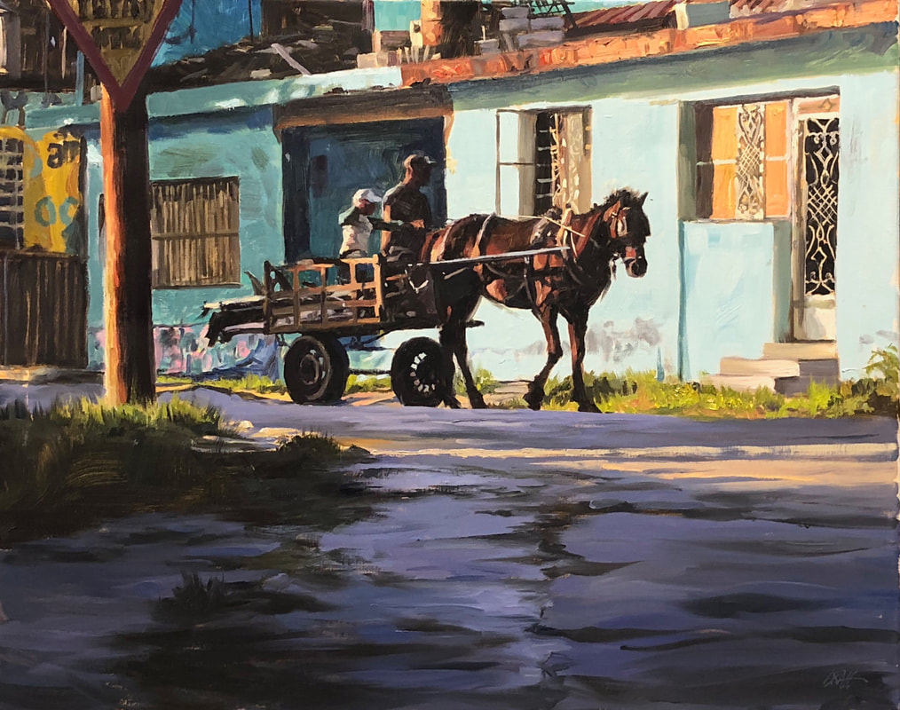 Street scene with horse pulling a cart with a father and child
