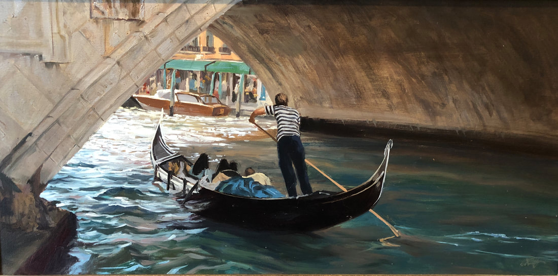 Gondola captain rowing a family under archway