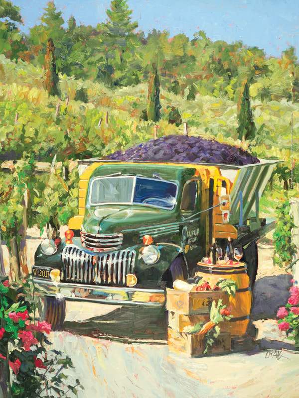 idyllic landscape of vintage green truck with grapes in the truck bed in a vineyard