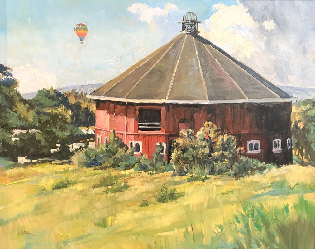 Red barn at Fountain Grove with hot air balloon in the background