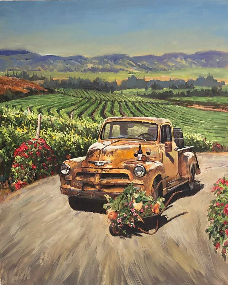 Vintage orange truck with in front of vineyard